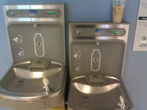 Image of two green drinking fountains that provide filtered water and bottle filling.