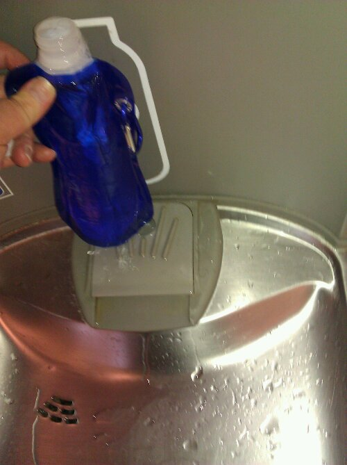 Image of collapseable water bottle being filled from filtered water bottle filling station